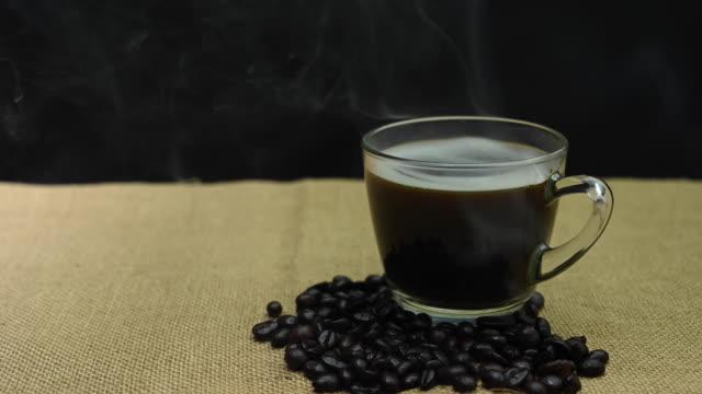 black coffee with smoke in a glass - кофеин стоковые видео и кадры b-roll