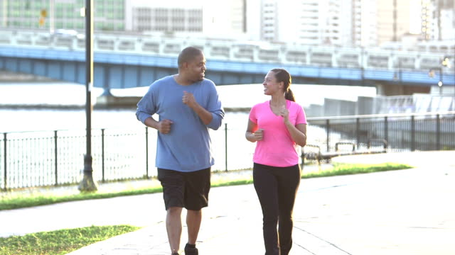 Black couple exercising together in the city video