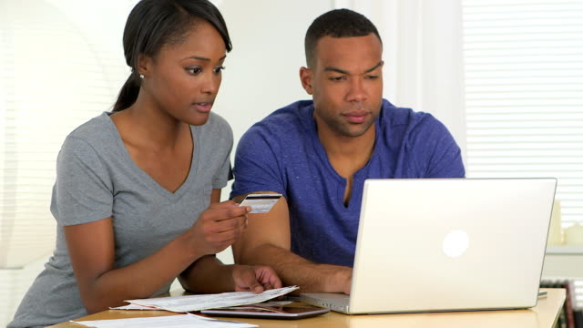 Black couple paying their bills video