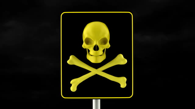 Black danger sign with yellow scary skull. video