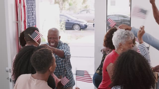 Black family arriving for a house party to celebrate Independence Day with relatives, elevated view Black family arriving for a house party to celebrate Independence Day with relatives, elevated view family 4th of july stock videos & royalty-free footage