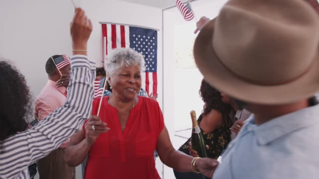 Black family celebrating Independence Day arriving for a house party with their relatives Black family celebrating Independence Day arriving for a house party with their relatives family 4th of july stock videos & royalty-free footage