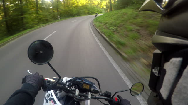 Black Forest Motorcycle Drive in Summer Driver Point of View 4K Motorbike driving through mountain curves in green summer forest in the south german black forest. First Person Driving Video. View from Motorbike Helmet. 4K Real Time Video. Black Forest, South Germany, Germany, Europe. motorcycle stock videos & royalty-free footage
