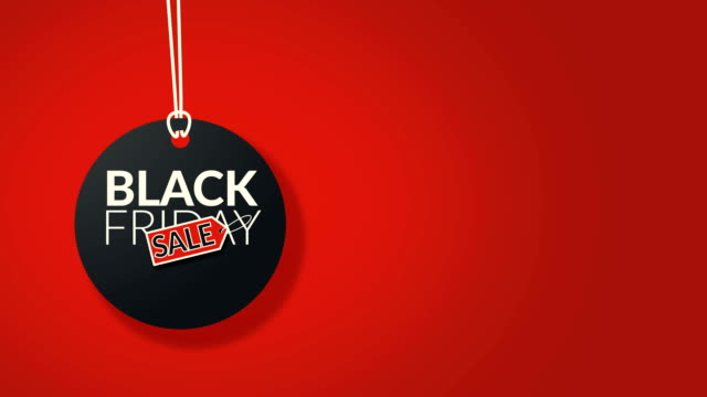 4k. black friday black color label with red sale tag hanging sign isolated on red background with copy space. black friday sale promotion for advertising - black friday стоковые видео и кадры b-roll