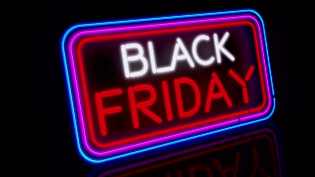 black friday neon flying 3 - black friday стоковые видео и кадры b-roll