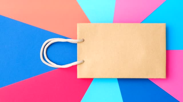 black friday shopping sale paper bag brand mockup - gif filmów i materiałów b-roll