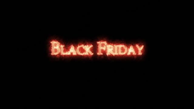 black friday written with fire. loop - call center стоковые видео и кадры b-roll