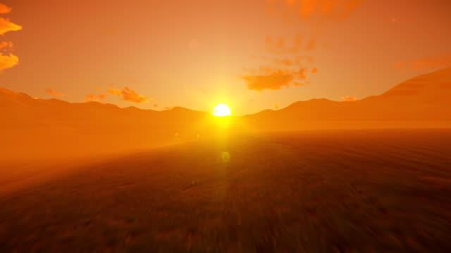 Black Hawk Helicopter crossing dessert against beautiful foggy sunrise, 4K