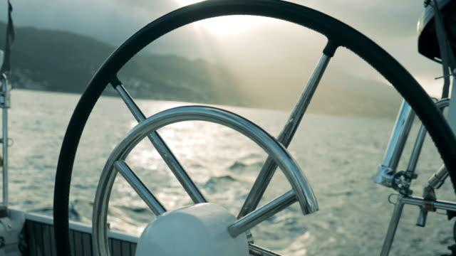 svart roder på en yacht i havet. - wheel black background bildbanksvideor och videomaterial från bakom kulisserna