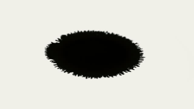Black ink drop to use as a matte for reveals or double exposure for titles etc video