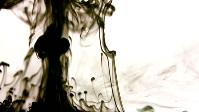 Black ink drops in water background