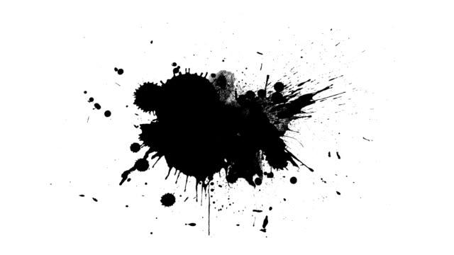 stockvideo's en b-roll-footage met zwarte inkt druppels - bespatterd