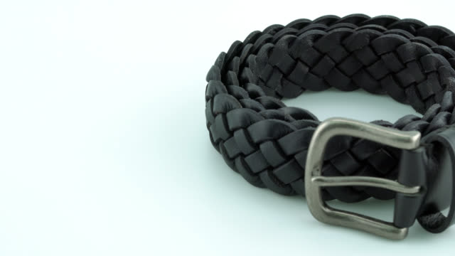Black leather belt on white background