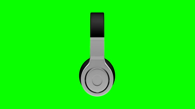black leather headphones isolated on green background 3d illustration render black leather headphones isolated on green screen chroma key background 3d illustration render 360 degrees looped rotation. bluetooth stock videos & royalty-free footage