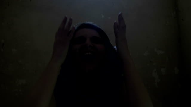 Black magic witch possessed by a demon laughing and raising hands calling dark spirits Black magic witch possessed by a demon laughing and raising hands calling dark spirits count dracula stock videos & royalty-free footage