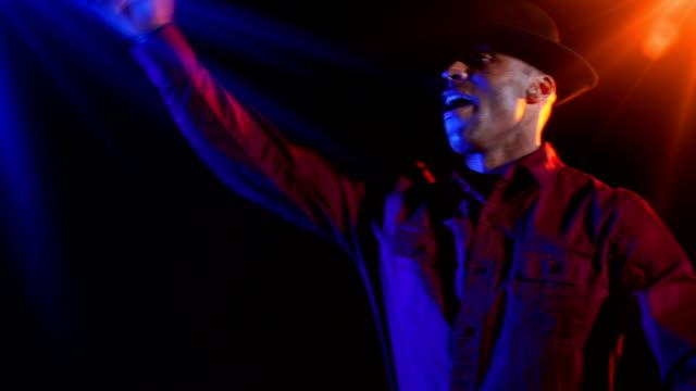 Black male disc jockey plays the music video