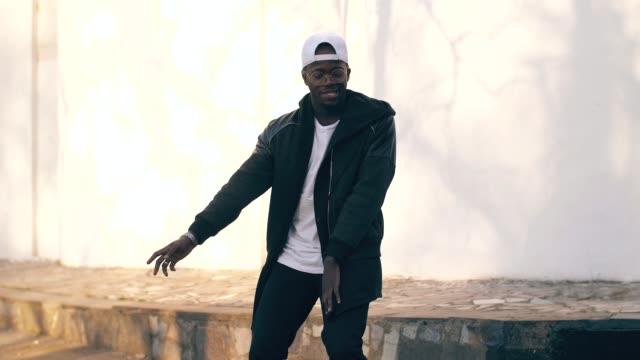 Black man dancing at the street