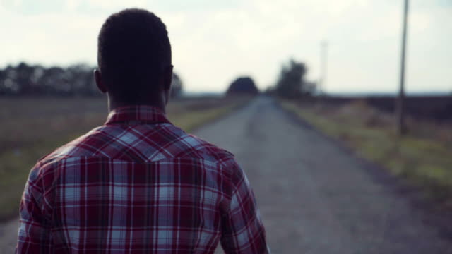 Black man going straight on countryside road video