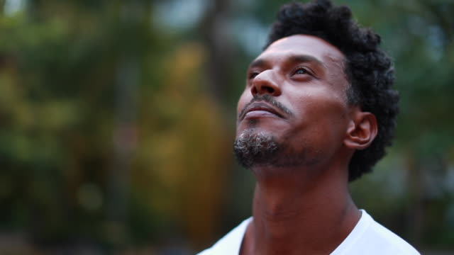 Black man looking at the sky outdoors Black man looking at the sky outdoors looking stock videos & royalty-free footage