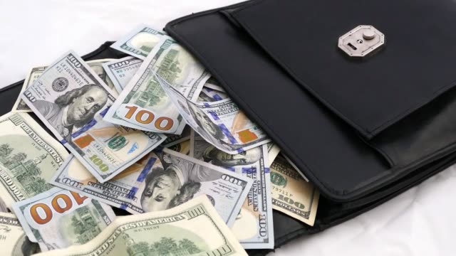 Black Money Bag Full Of Dollars Bags And Many 100 Usd