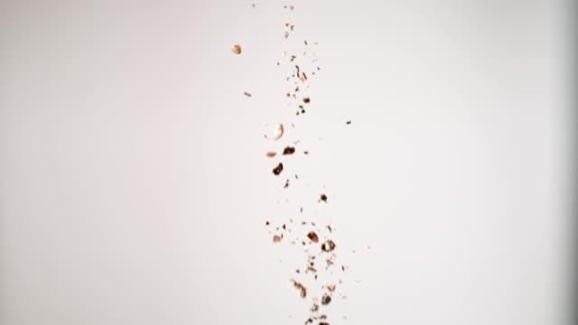 Black Pepper falling down. Studio shot