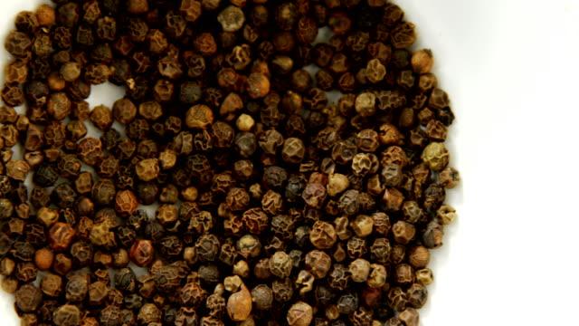 Black pepper in bowl 4k video