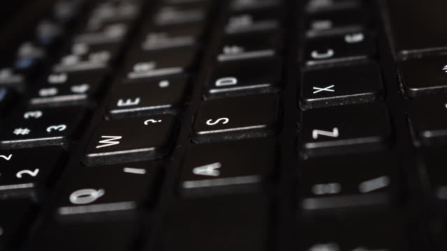 Black QWERTY keyboard rack focus Changing focus, shallow depth of field, QWERTY letters on a laptop keyboard keypad stock videos & royalty-free footage
