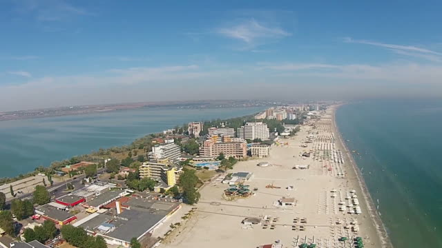 Black Sea coast riviera, in Eastern Europe , with Mamaia strip, a top travel destination in Romania , aerial hover