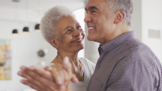 black senior couple dancing - senior filmów i materiałów b-roll