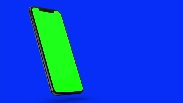 Black smartphone turns on on blue background. Easy customizable green screen. Computer generated image.