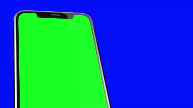 Black smartphone turns on on blue background. Easy customizable green screen. Computer generated image. Black smartphone turns on on blue background. Easy customizable green screen. Computer generated image electronics store stock videos & royalty-free footage