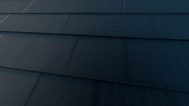 Black solar roof concept. Building-integrated photovoltaics system consisting of modern monocrystal black solar roof tiles. 3d rendering. Black solar roof concept. Building-integrated photovoltaics system consisting of modern monocrystal black solar roof tiles. 3d rendering. tile stock videos & royalty-free footage