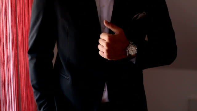 Black suit with tie and beautiful watch video