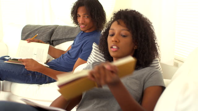 Black teen couple helping each other with homework video