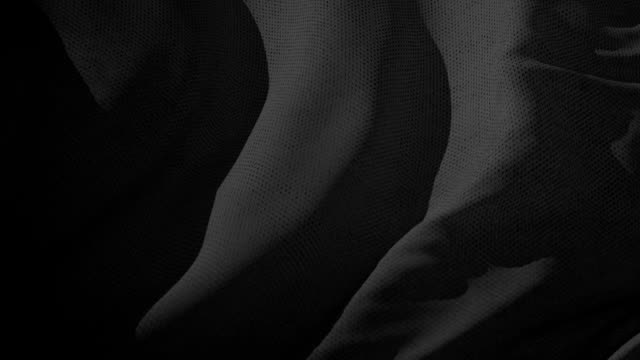 Black textile fabric waving in the wind abstract background video