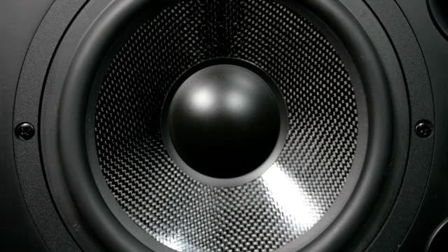 A black vibrating working subwoofer video