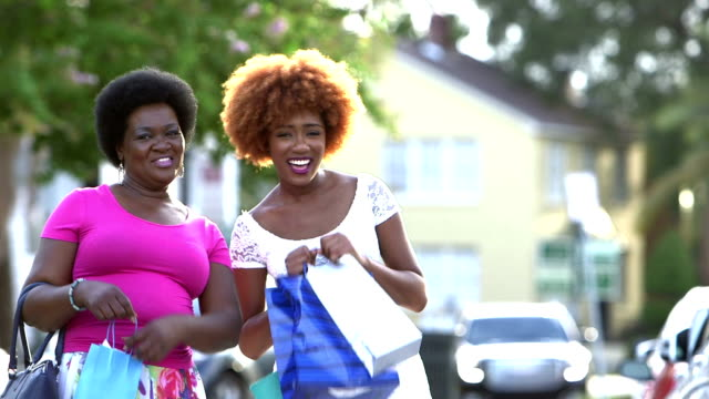 Black woman and her adult daughter shopping in the city video