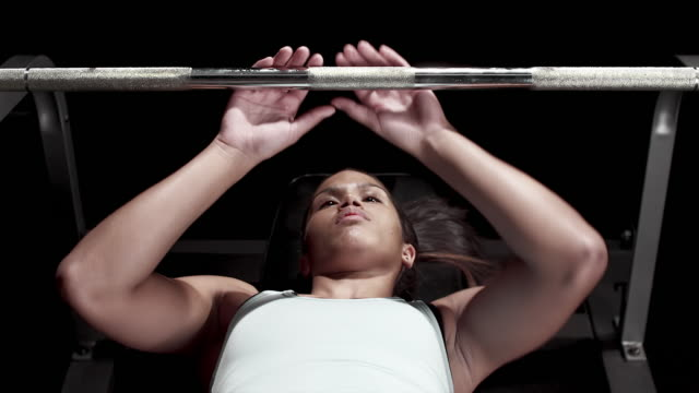 Black Woman lifting a bench press video