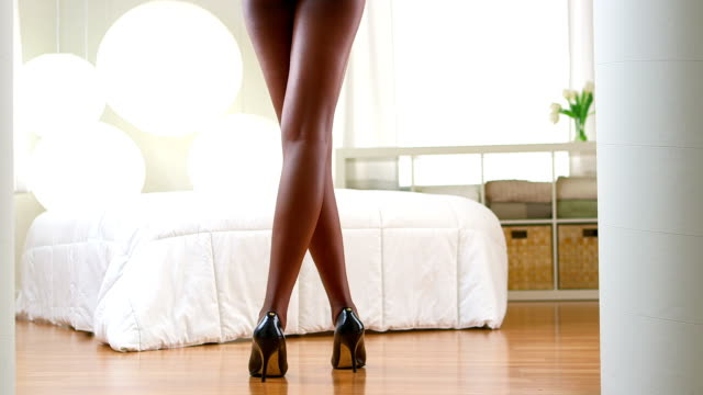 Black woman standing in lingerie video