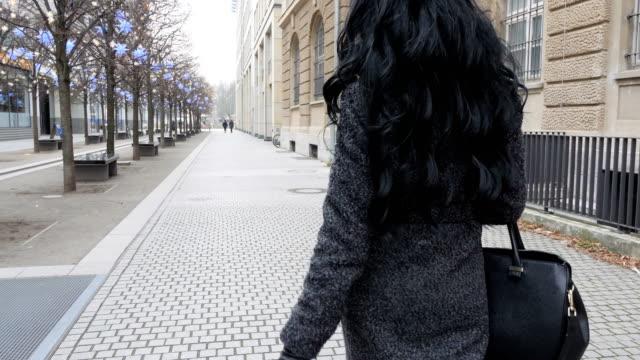 Black woman walking at the street
