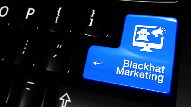 ブラック ハット マーケティング移動モーションに青い入力ボタンに現代コンピューターのキーボード テキストおよびアイコン ラベル付きの。選択したフォーカス キーは押すとアニメーシ� - 鎖の輪点の映像素材/bロール