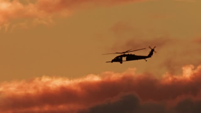 Blackhawk helicopter USAF USMC flying into a fiery sunset Okinawa Japan Blackhawk helicopter USAF marines flying into a fiery sunset Okinawa Japan army stock videos & royalty-free footage
