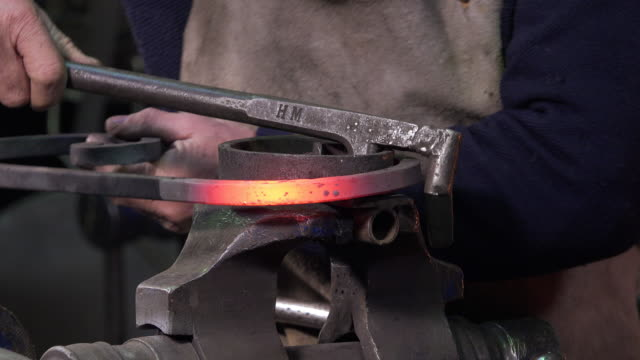blacksmith artist in his workshop video