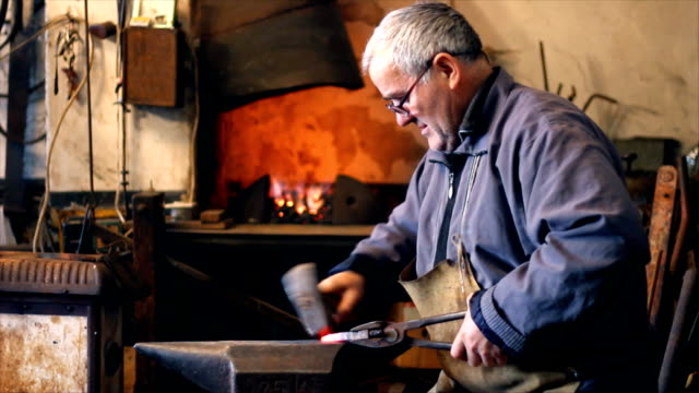 Blacksmith at work Blacksmith at work, hit with a hammer by a hot metal on the anvil anvil stock videos & royalty-free footage
