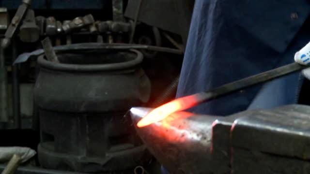 Blacksmith forges metal video