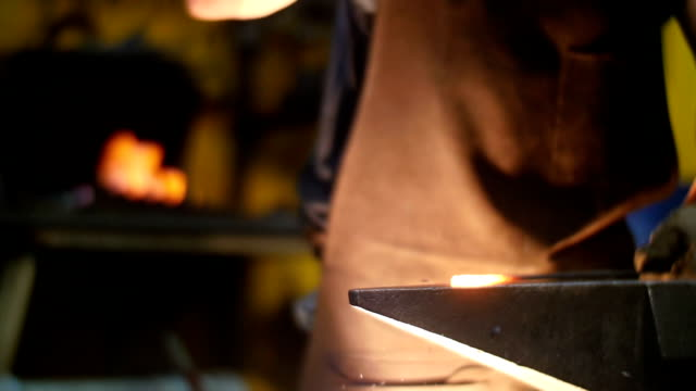 Blacksmith Forging a Sword in a Workshop on an Anvil Slow Motion video