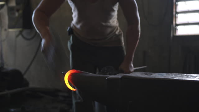 Blacksmith forging hot iron on the anvil Blacksmith forging hot iron on the anvil blacksmith stock videos & royalty-free footage