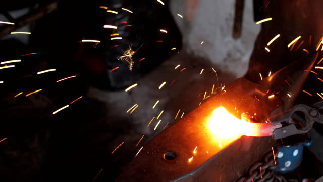 Blacksmith Hammering Heated Iron on Anvil video