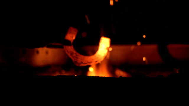 HD: Blacksmith Heating A Horseshoe HD1080p: Blacksmith heating a horseshoe in the fire. blacksmith shop stock videos & royalty-free footage