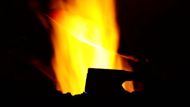 Blacksmith Holding a Glowing Heated Knife over Fire video